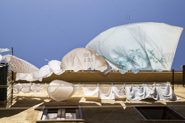 Sicily- Cefalu- drying laundry- wind- low angle view