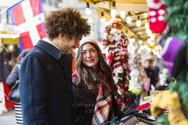 Happy young couple at Christmas market