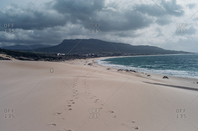 Spain- Tarifa- beach with footmarks in the sand