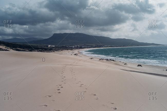 Spain- Tarifa- beach with footmarks in the sand