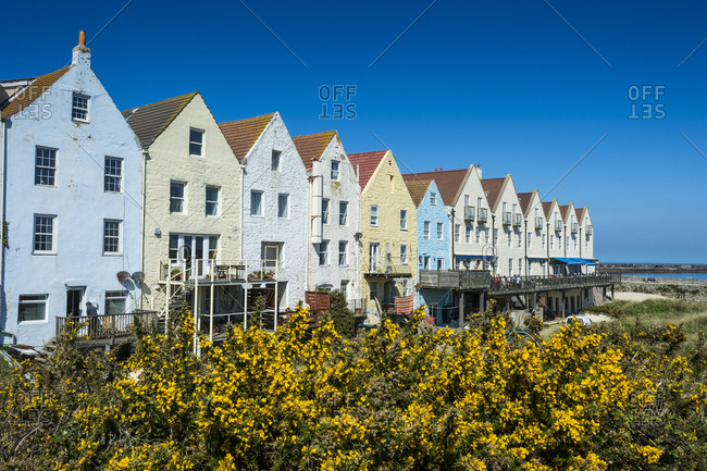 April 6, 2015: United Kingdom- Channel Islands- Alderney- renovated houses formerly the docks in Braye