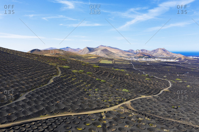 Spain- Canary Islands- Lanzarote- wine growing area La Geria villages Uga and Yaiza- Ajaches mountains- aerial view