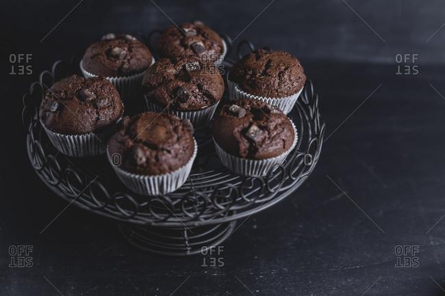 Chocolate muffins on cake stand