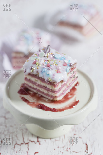Biscuit with raspberry cream with marzipan and sugar glaze