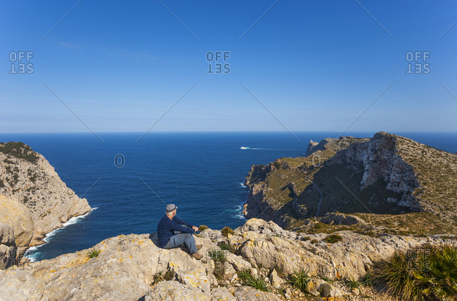 Spain- Balearic Islands- Mallorca- Cap de Formentor- hiker looking at distance