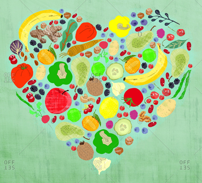 Different slices of fruit and vegetables arranged in a heart shape on a green background