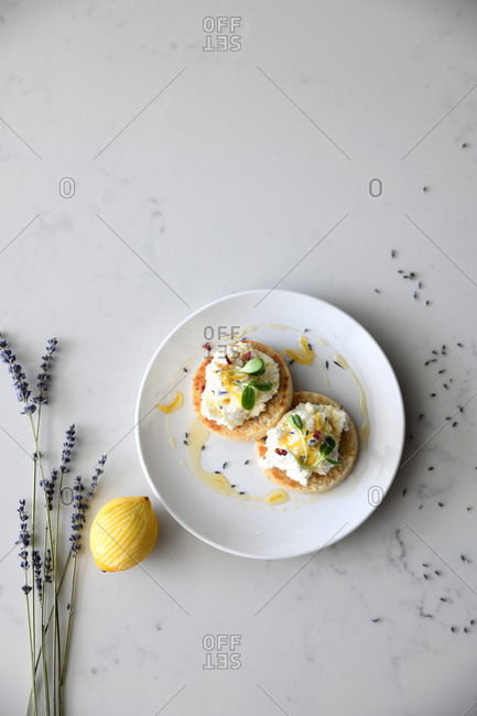Top view of a gourmet pastry with lemon, honey and lavender