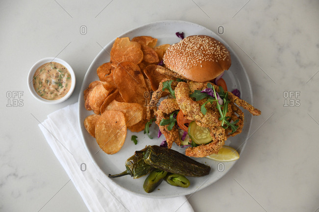 Fried crab sandwich and chips