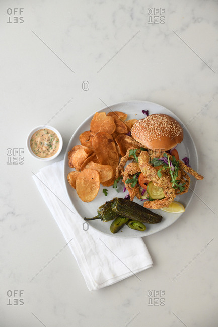 Fried soft-shell crab sandwich and chips