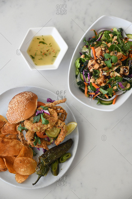 Fried crab sandwich served with a tofu salad