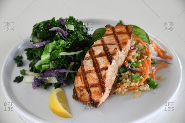 Gourmet salmon dish with salad