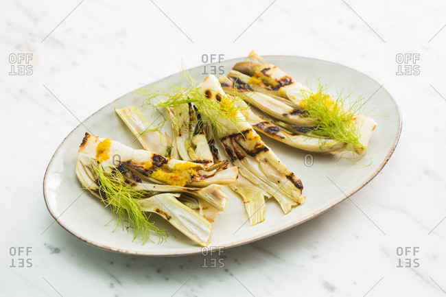 Grilled veggies and herbs on a plate