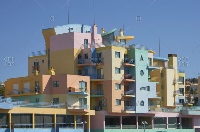 Albufeira, Portugal - September 26, 2018: Multicolored art-deco apartments in Albufeira, Portugal