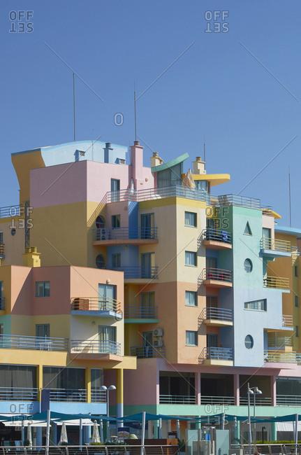 Albufeira, Portugal - September 26, 2018: Multicolored art-deco apartment buildings in Albufeira, Portugal