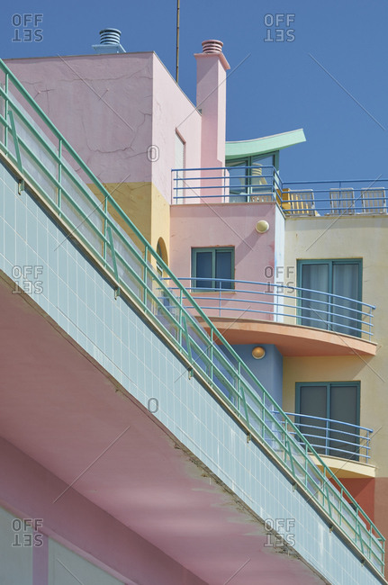 Low angle view of colorful art-deco apartments in Albufeira, Portugal