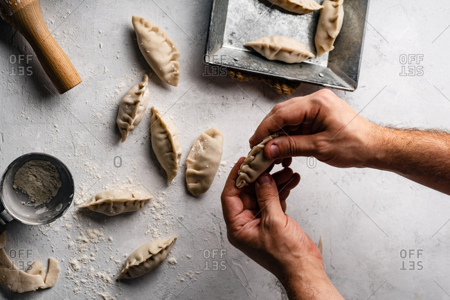 Wrapping raw gyoza dumplings with pork