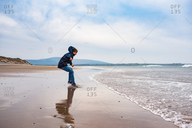 Boy jumping at the beach