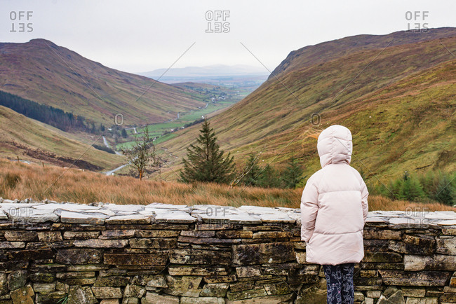 Girl looking at a valley