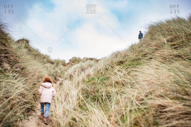 Children climbing sand dunes