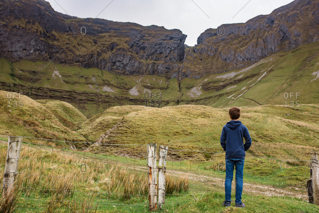 Boy looking Mountains in Ireland