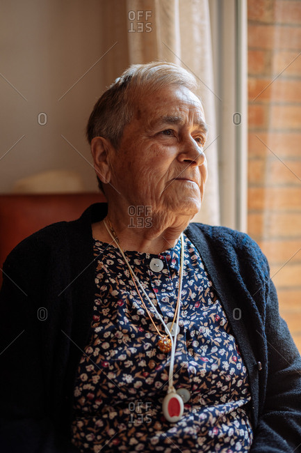 Elderly woman with personal alarm hanging from the neck