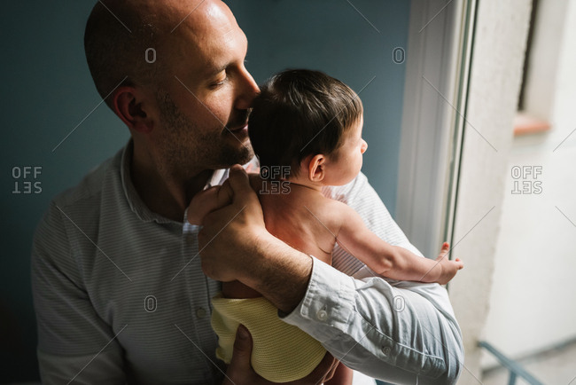 Father hugging cute baby