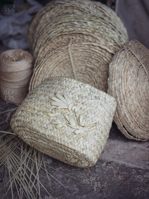 Lovely wicker and braided rolls placed on grungy floor of workshop