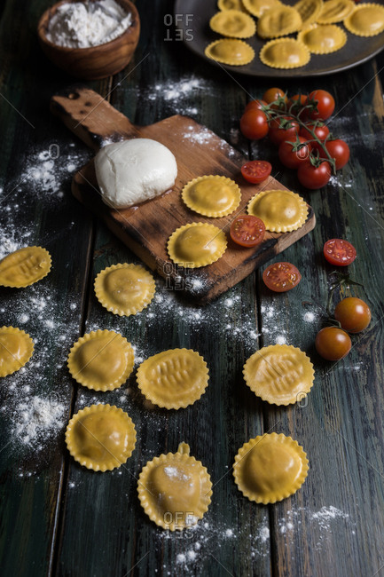 Homemade ravioli made with parmesan cheese, tomato and basil. Typical dish of Italian cuisine