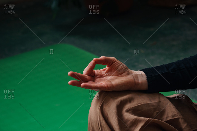 Close-up of female hand making gyan mudra as a part of meditation