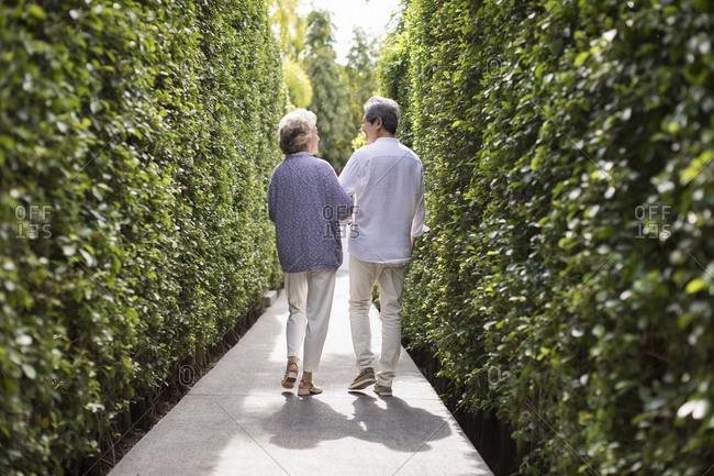 Happy senior couple walking arm in arm