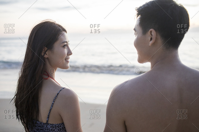 Happy young couple dating on beach