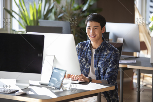 Young college student using computer