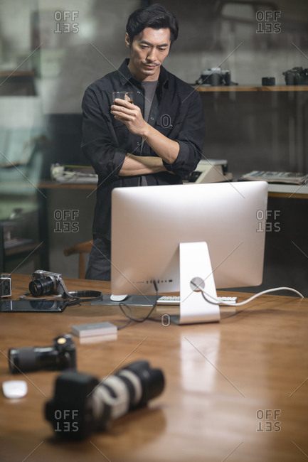 Photographer using computer in studio