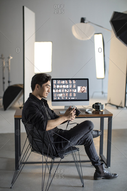 Photographer in studio - Offset Collection