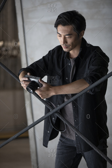 Photographer using camera in studio