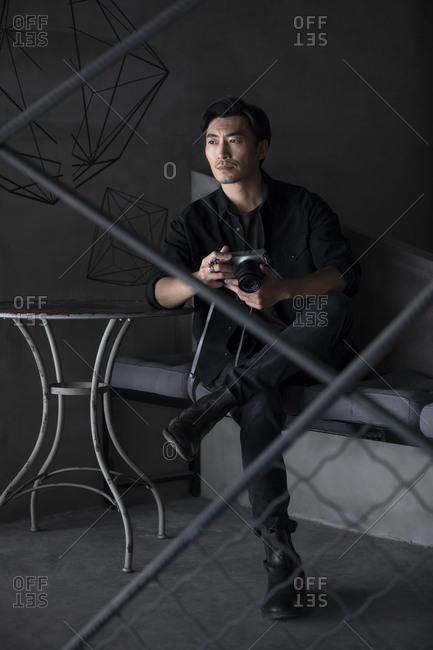 Photographer using camera in studio