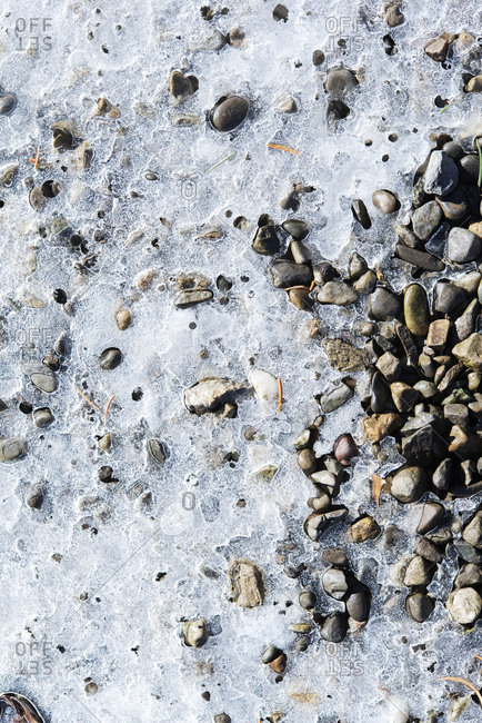 Ice over pebbles