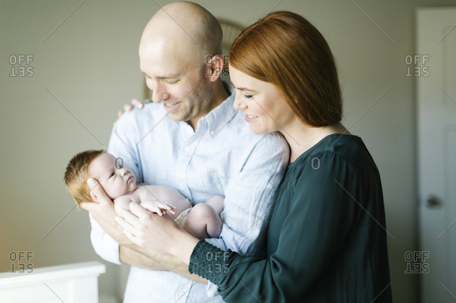 Couple holding their newborn son