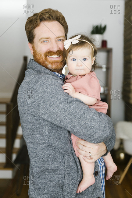 Smiling father holding his baby girl