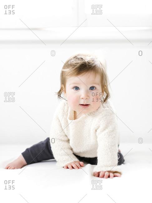 Baby girl wearing white sweater
