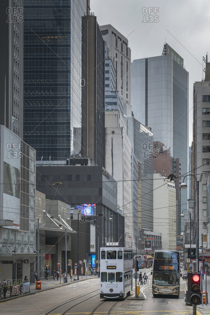 China, Hong Kong, - November 11, 2018: Double-decker tram and bus on street in Hong Kong, China