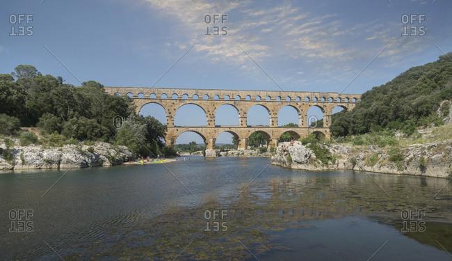 France,  Vars, Pont du Gard, Roman aqueduct, - July 2, 2018: Pont du Gard over Gardon River in Vers-Pont-du-Gard, France