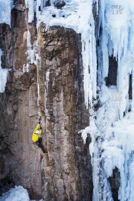 Man ice climbing in Ouray, USA