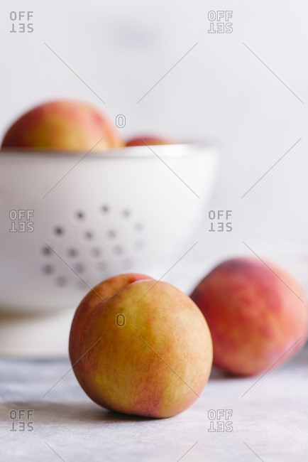 Peaches with colander