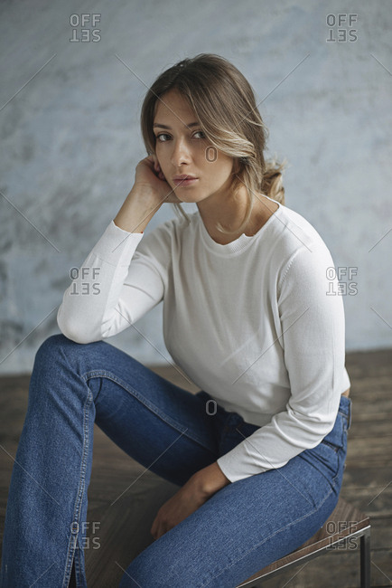 Young woman wearing white sweater