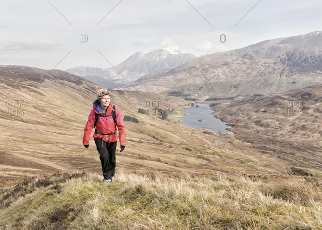 UK- Scotland- Onich- Beinn Na Gucaig- woman hiking in mountain scenery