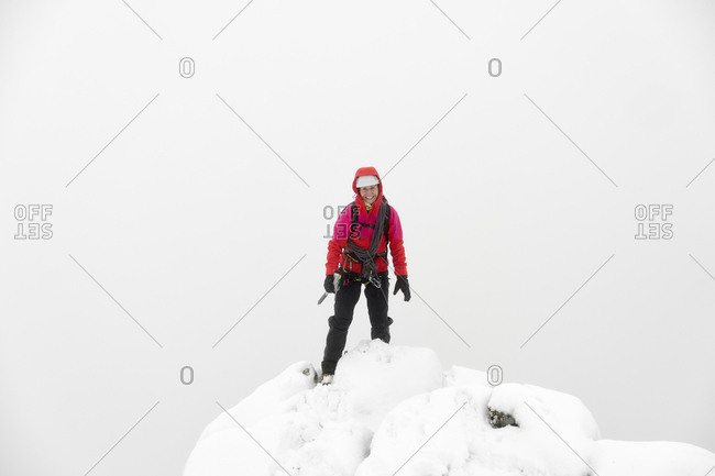 UK- Scotland- Glen Spean- woman on peak of Beinn a Caorainn in winter