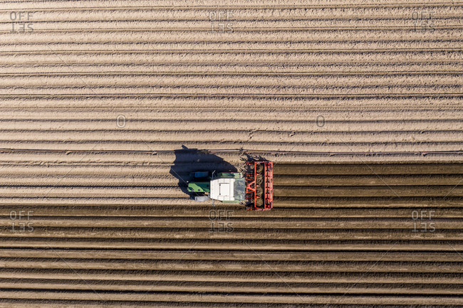 Germany- Hesse- Aerial view of tractor on asparagus field