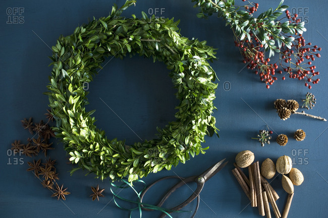 Selfmade Advent wreath- box twigs- rosehip- star anise- cinnamon sticks- walnuts and almonds