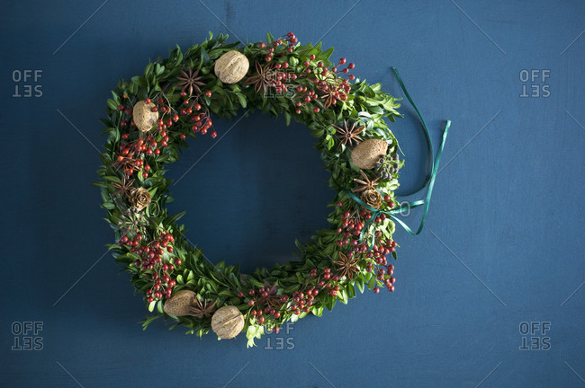 Selfmade Advent wreath- box twigs- rosehip- star anise- walnuts and almonds